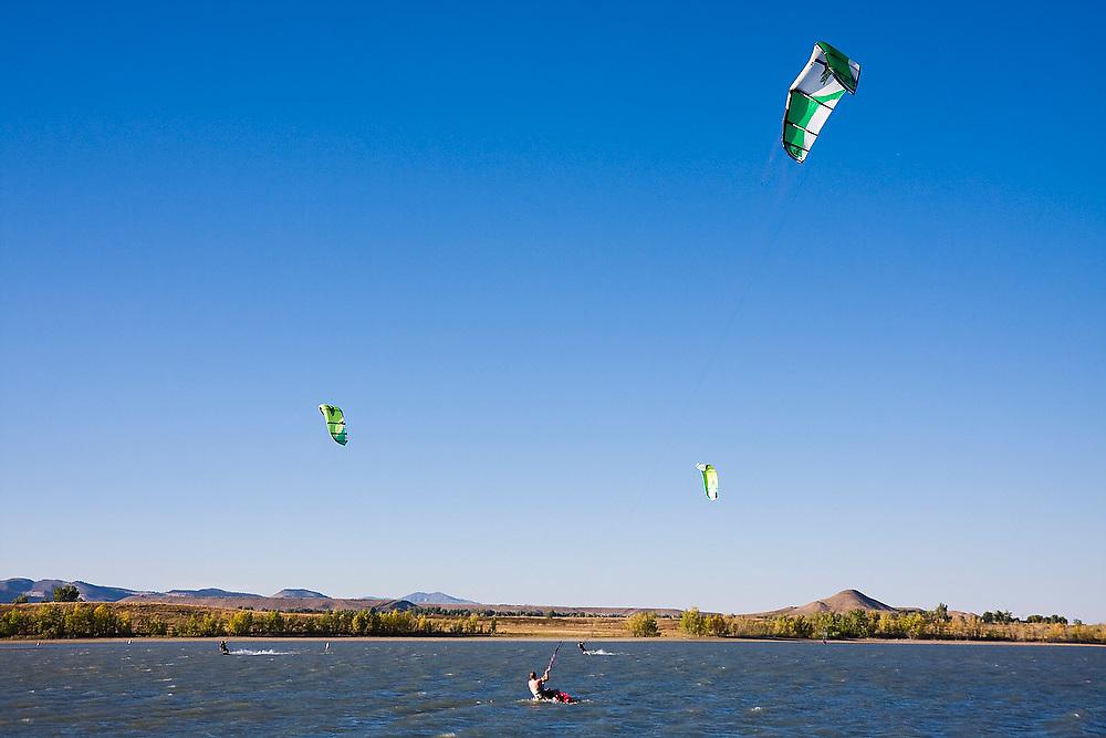 Kite boarders on Boulder Reservoir outside Boulder, Colorado.