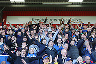AFC Wimbledon fans celebrates sealing a play-off position during the Sky Bet League 2 match between Stevenage and AFC Wimbledon at the Lamex Stadium, Stevenage, England on 30 April 2016. Photo by Stuart Butcher.
