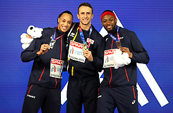 Cyprus' Milan Trajkovic (centre), France's Pascal Martinot-Lagarde (left) and Aurel Manga celebrate with their medals after the Men's 60m Hurdles during day three of the European Indoor Athletics Championships at the Emirates Arena, Glasgow.