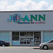 A Jo-Ann fabric storefront is open as an essential business  on Friday, March 27, 2020 in Orlando, Florida. Jo-Ann is providing free materials, sewing machines, workspace and guidance in their stores so that individuals can safely make gowns and masks for immediate donation to local hospitals. (Alex Menendez via AP)