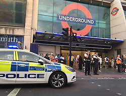 © Licensed to London News Pictures. 21/07/2021. London, UK. Police officers are seen at Brixton Underground after a fatal stabbing in south London. An investigation is underway after a man died following a stabbing in Brixton. Police were called at 20:18hrs on Wednesday, 21 July to reports of an assault close to Brixton Underground Station. Officers attended and found a man, believed to be aged in his early 20s, suffering from a stab injury. They immediately provided first aid. The London Ambulance Service and London's Air Ambulance also attended but despite their efforts the man was pronounced dead at the scene at the 20:45hrs. His next of kin has been informed and are being supported by officers. Formal identification has not taken place. A man was arrested nearby on suspicion of causing grievous bodily harm. Photo credit: Andy Gatt/LNP