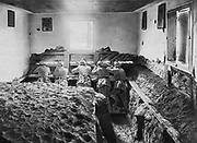 World War I 1914-1918: Eastern Front.  German soldiers in a defensive position in the basement of a house where they have entrenched the floor, Vistula region of Poland 1915, which was devastated by retreating Russians.