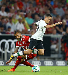 August 1, 2017 - Munich, Germany - Arturo Vidal of Bayern tackling on Philippe Coutinho of Liverpool during the second Audi Cup football match between FC Bayern Munich and FC Liverpool in the stadium in Munich, southern Germany, on August 1, 2017. (Credit Image: © Matteo Ciambelli/NurPhoto via ZUMA Press)