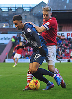 Preston North End's Callum Robinson vies for possession with Barnsley's Marc Roberts<br /> <br /> Photographer Chris Vaughan/CameraSport<br /> <br /> The EFL Sky Bet Championship - Barnsley v Preston North End - Saturday 4th February 2017 - Oakwell Stadium - Barnsley<br /> <br /> World Copyright © 2017 CameraSport. All rights reserved. 43 Linden Ave. Countesthorpe. Leicester. England. LE8 5PG - Tel: +44 (0) 116 277 4147 - admin@camerasport.com - www.camerasport.com