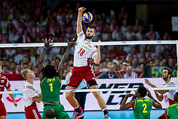 06.09.2014, Jahrhunderthalle, Breslau, POL, FIVB WM, Kamerun vs Polen, Gruppe A, im Bild Marcin Mozdzonek (POL), Olivier Nongni Zanguim Mefani (CMR) // during the FIVB Volleyball Men's World Championships Pool A Match beween Cameroon and Poland at the Jahrhunderthalle in Breslau, Poland on 2014/09/06. EXPA Pictures © 2014, PhotoCredit: EXPA/ Newspix/ Lukasz Skwiot<br /> <br /> *****ATTENTION - for AUT, SLO, CRO, SRB, BIH, MAZ, TUR, SUI, SWE only*****