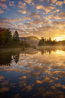 Beautiful autumn sunrise on Turtlehead Pond, Groton State Forest, Marshfield, Vermont