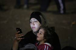 © London News Pictures. Migrants wait to get into the camp close to the Hungarian and Serbian border town of Roszke, Hungary, September 7 2015. The UN's humanitarian agencies are on the verge of bankruptcy and unable to meet the basic needs of millions of people because of the size of the refugee crisis in the Middle East, Africa and Europe, senior figures within the UN have told the media.   Picture by Paul Hackett /LNP
