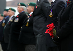 Poppies are held during a remembrance service in Fort William on the 100th anniversary of the signing of the Armistice which marked the end of the First World War.