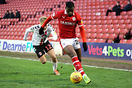 Barnsley forward Mamadou Thiam (26) beats Charlton Athletic midfielder Ben Reeves (12)  during the EFL Sky Bet League 1 match between Barnsley and Charlton Athletic at Oakwell, Barnsley, England on 29 December 2018.