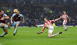 Stoke City's Peter Crouch makes an attempt at goal during the Premier League match at Turf Moor, Burnley.