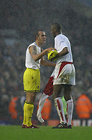 Photo: Jo Caird, Digitalsport<br /> NORWAY ONLY<br /> <br /> Arsenal v Charlton Athletic<br /> Barclaycard Premiership 2004<br /> 28/02/2004.<br /> <br /> Di Canio and Viera swap shirts in the snow