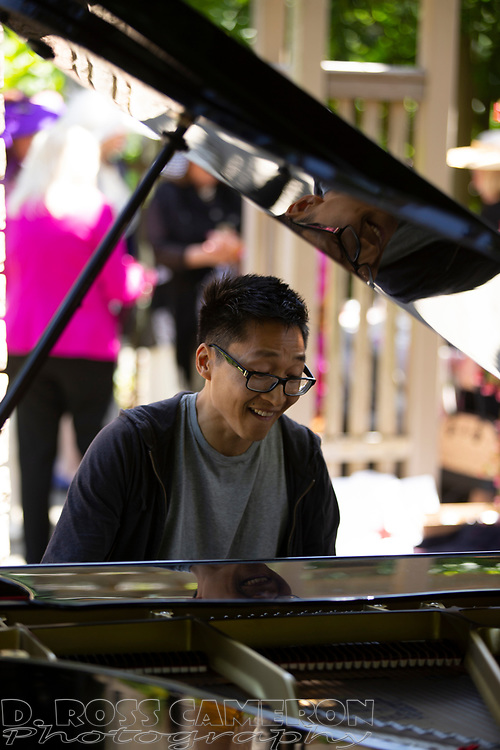 An unidentified pianist performs a piece by 19th century German composer Robert Schumann, at the fifth annual Flower Piano exhibition at the San Francisco Botanical Garden in Golden Gate Park, Friday, July 19, 2019 in San Francisco. The exhibition continues through Monday. (Photo by D. Ross Cameron)