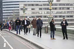 © Licensed to London News Pictures.23/03/2017.London, UK.   Westminster  Bridge is opened the day after a lone terrorist killed 4 people and injured several more, in an attack using a car and a knife. The attacker managed to gain entry to the grounds of the Houses of Parliament, killing one police officer.Photo credit: Peter Macdiarmid/LNP