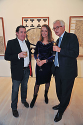 Left to right, JOOLS HOLLAND, SABRINA GUINNESS and JOHN MAKINSON at a private view of work by Brian Clarke - Works on Paper 1969-2011 held in the Phillips de Pury Galleries, The Saatchi Gallery, London on 28th February 2011.