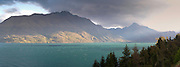 A sunset view of the turquoise waters of Lake Wakatipu, taken from the Glenorchy-Queenstown Highway, Otago, New Zealand