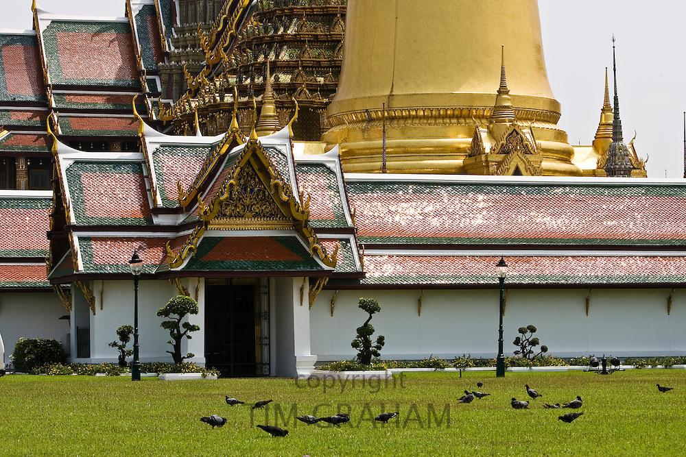 Roofs of the Prasat Phra Thep Bidon and Phra Sri Ratana Chedi, Bangkok, Thailand.