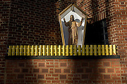 An effigy of Jesus Christ encased in a shrine box outside a Catholic church in Camberwell, south London.