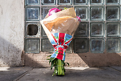 © Licensed to London News Pictures. 04/06/2017. London, UK. Flowers with the message 'Pure Evil Act R.I.P. London Will Never Give In' are left at a police cordon near Borough Market after a terrorist incident in which seven people are reported to have been killed. A white van veered off the road hitting a number of pedestrians before several men attacked people with knives. Photo credit: Rob Pinney/LNP