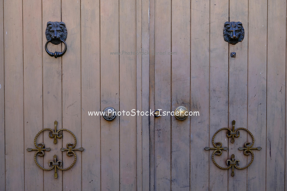 ornate door knockers photographed in Catania, Sicily, Italy
