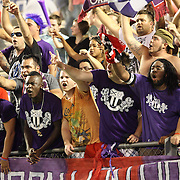 Orlando City soccer fans chant during an International Friendly soccer match between English Premier League team Newcastle United and the Orlando City Lions of the United Soccer League, at the Florida Citrus Bowl on Saturday, July 23, 2011 in Orlando, Florida. Orlando won the match 1-0. (AP Photo/Alex Menendez)