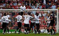 Fotball<br /> England 2005/2006<br /> Foto: SBI/Digitalsport<br /> NORWAY ONLY<br /> <br /> FA Barclays Premiership<br /> Middlesbrough v Charlton<br /> 28/08/2005.<br /> <br /> Charlton's Chris Perry is mobbed after his goal as Hermann Hreidarsson jumps for joy in the background.