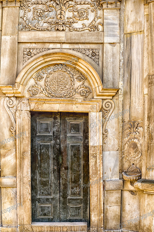 Ornate Entry door to the Historic Sabil wa Kuttab of Tusun Pasha, decorated with carved marble reliefs, located in Al-Muizz street