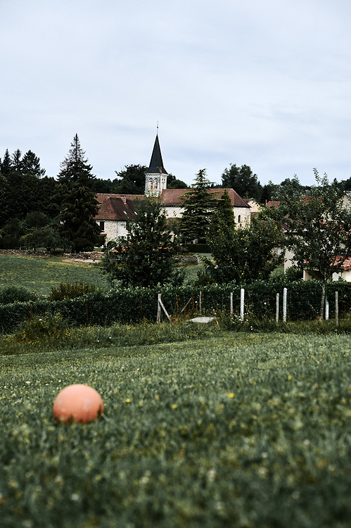 A view at the village, including the church, from the school's garden. Saint-Pierre-de-Frugie, France. July 12, 2019.