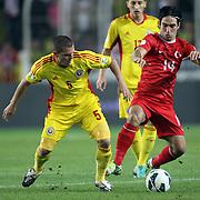 Turkey's Arda Turan (R) and Romania's Alexandru Bourceanu (L) during their FIFA World Cup 2014 qualifying soccer match Turkey betwen Romania at Sukru Saracoglu stadium in Istanbul october 12, 2012. Photo by TURKPIX