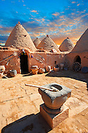 """Pictures of the beehive adobe buildings of Harran, south west Anatolia, Turkey.  Harran was a major ancient city in Upper Mesopotamia whose site is near the modern village of Altınbaşak, Turkey, 24 miles (44 kilometers) southeast of Şanlıurfa. The location is in a district of Şanlıurfa Province that is also named """"Harran"""". Harran is famous for its traditional 'beehive' adobe houses, constructed entirely without wood. The design of these makes them cool inside. 25 .<br /> <br /> If you prefer to buy from our ALAMY PHOTO LIBRARY  Collection visit : https://www.alamy.com/portfolio/paul-williams-funkystock/harran.html<br /> <br /> Visit our TURKEY PHOTO COLLECTIONS for more photos to download or buy as wall art prints https://funkystock.photoshelter.com/gallery-collection/3f-Pictures-of-Turkey-Turkey-Photos-Images-Fotos/C0000U.hJWkZxAbg ."""