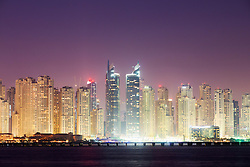 Night view of residential towers at Jumeirah Beach Residence (JBR) at Marina in Dubai United Arab Emirates