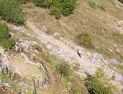 Man walking on ancient mountain path in Sierra de Grazalema natural park, Cadiz province, Spain