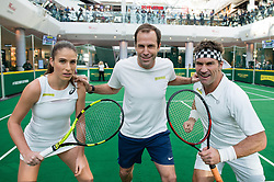 EDITORIAL USE ONLY<br /> Great Britain&Otilde;s Johanna Konta plays tennis against former Wimbledon champion Pat Cash, umpired by Greg Rusedski (centre) to celebrate the release of new tennis movie &Ocirc;Battle of the Sexes&Otilde;, in partnership with cereal bar Nature Valley, at Westfield London in Shepherd&Otilde;s Bush.