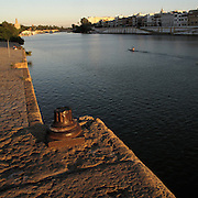 Guadalquivir river, Seville, Andalusia region, Spain . The WAY OF SAINT JAMES or CAMINO DE SANTIAGO following the Silver Way, between Seville and Astorga, SPAIN. Tradition says that the body and head of St. James, after his execution circa. 44 AD, was taken by boat from Jerusalem to Santiago de Compostela. The Cathedral built to keep the remains has long been regarded as important as Rome and Jerusalem in terms of Christian religious significance, a site worthy to be a pilgrimage destination for over a thousand years. In addition to people undertaking a religious pilgrimage, there are many travellers and hikers who nowadays walk the route for non-religious reasons: travel, sport, or simply the challenge of weeks of walking in a foreign land. In Spain there are many different paths to reach Santiago. The three main ones are the French, the Silver and the Coastal or Northern Way. The pilgrimage was named one of UNESCO's World Heritage Sites in 1993. When there is a Holy Compostellan Year (whenever July 25 falls on a Sunday; the next will be 2010) the Galician government's Xacobeo tourism campaign is unleashed once more. Last Compostellan year was 2004 and the number of pilgrims increased to almost 200.000 people.