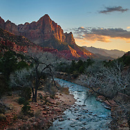 The Watchman catches the last light of the day as it guards the entrance of Zion National Park.
