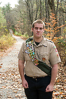 Thomas Hayes stands at the start of the trail where he widened and added gravel as part of his Eagle Scout project in the Jeff Marden Forest in Belmont.  (Karen Bobotas/for the Laconia Daily Sun)