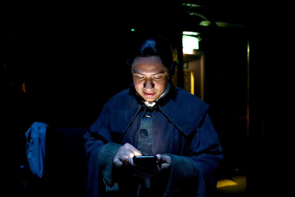 Performer Performer Eleazar Rodriguez checks his phone as he waits to go onstage during a performance of the Barber of Seville at the English National Opera in London, Britain, 30 October 2017.  English National Opera (ENO) is an opera company based in London. It is one of the two principal opera companies in London. English National Opera traces its roots back to 1931 when Lilian Baylis established the Sadler's Wells Opera Company at the newly re-opened the Sadler's Wells Theatre. Baylis had been presenting opera concerts and theatre in London since 1898 and was passionate about providing audiences with the best theatre and opera at affordable prices. ENO became the first British opera company to tour the United States, and the first major foreign opera company to tour what was then the Soviet Union.EPA-EFE/NEIL HALL