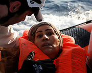 A migrant reacts after being rescued by the Malta-based NGO Migrant Offshore Aid Station (MOAS) after they were spotted adrift on board a wooden boat in the central Mediterranean north of Sabratha on the Libyan coast, April 5, 2017. REUTERS/Darrin Zammit Lupi
