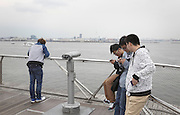 Japanese teenagers absorbed in their smartphone