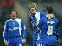Photo: Aidan Ellis.<br /> Preston NE v Cardiff City. Coca Cola Championship.<br /> 19/11/2005.<br /> Cardiff's Jason Koumas congratulates goal scorer Glen Loovens
