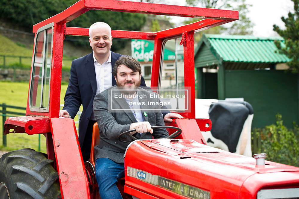 Pictured: Mark Ruskell hitches a lift on a Massey Ferguson tractor driven by local candidate Dan Heap<br /> Scottish Greens on local election campaign trail. Mark Ruskell MSP, the party's environment spokesperson, joined candidate for the Sighthill/Gorgie ward Dan Heap on a visit to Gorgie city farm. The pair met Chief executive of the farm, Josiah Lockhart and Development and fundraising manager, Sarah Campbell during their tour.<br /> <br /> <br /> Ger Harley | EEm 19 April 2017