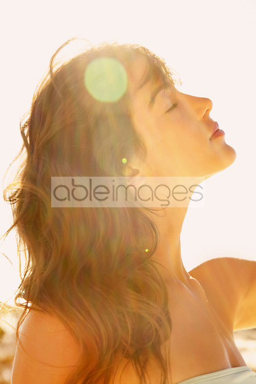 Profile of Young Woman in Sunlight