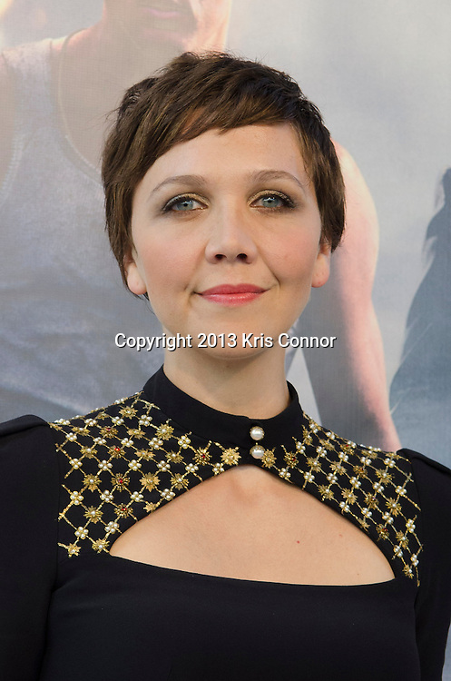 WASHINGTON DC JUNE 21: Maggie Gyllenhaal poses on the red carpet during the DC premiere of White House Down at AMC Georgetown in Washington DC on June 21, 2013.<br /> Photo by Kris Connor/Sony Pictures