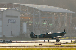 "© Licensed to London News Pictures. File picture dated 13/12/2012. Bristol, UK. The Mark IX Spitfire circa 1943 taking off past the Airbus factory. Engineers race to finish work rebuilding a Mark IX Spitfire fighter circa 1943, at Filton airfield near Bristol. The plane has been rebuilt  by John Hart engineering, it is the last plane to be completed at the airfield and was flown out on 18 December 2012 by pilot Bill Perrins. Filton, the birthplace of the British-built Concorde jets, is to close on Friday (21st December 2012). Its owner BAE Systems says it is not viable and intends to sell it for housing and business development. BAE Systems said the airfield was closing following a comprehensive assessment over a five-year period and an independent review, ""both of which concluded that the airfield was not economically viable"".  Airbus has said it is fully committed to the Filton site, where it has a base making aircraft wings.  A spokesman said: ""The closure of the airfield will have no significant effect on our business and we have mitigation plans in place regarding the change of venue for our passenger shuttle (using Bristol airport) and the transportation of the A400M wings (via Portbury docks).  Planes currently based at Filton will have to find new homes. The airfield officially closes for flights this Friday, though the police helicopter will still be based there. BAE is supporting a new museum at Filton to ""house Concorde Alpha-Foxtrot and Bristol's aviation heritage."".Photo credit : Simon Chapman/LNP"
