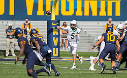 Oct 3, 2020; Morgantown, West Virginia, USA; Baylor Bears quarterback Charlie Brewer (5) throws a pass during the first quarter against the West Virginia Mountaineers at Mountaineer Field at Milan Puskar Stadium. Mandatory Credit: Ben Queen-USA TODAY Sports