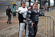 A comic book fan gets into costume on the first day of MCM Comic Con 2019 at Excel centre on 25th October 2019 in London, England, United Kingdom.