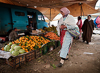 FEZ, MOROCCO - CIRCA MAY 2018:  Merchants and buyers on a typical market in the outskirts of Fez in Morocco