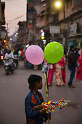 Child selling ballons in the market on 21st February 2018 in Jodhpur, Rajasthan, India. Popularly known as the Blue City, Jodhpur is a city in the Thar Desert of the northwest Indian state of Rajasthan.  In 2011, the national census of India found the total number of child labourers, aged [5–14], to be at 10.1 million, out of the total of 259.64 million children.