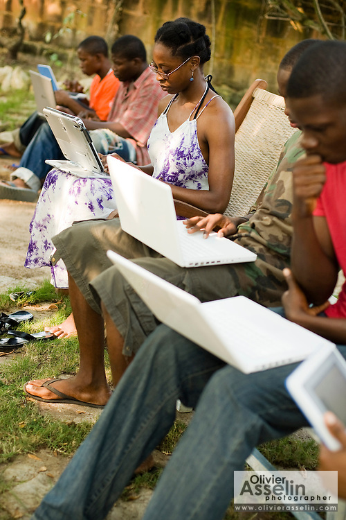 Students use laptops to browse the internet over a wireless network at the Kokrobitey Institute in the town of Kokrobitey, 30km west of Ghana's capital Accra on Sunday January 18, 2009. From left to right Abass Aryee, Oti Dodoo, Nana Ama Bentsi-Enchill, Kenful Agbemenya, Simon Mensah.