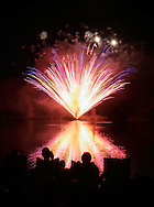 Middletown, New York - People watch the fireworks explode over the lake at Fancher-Davidge Park during a Stars and Stripes celebration on July 2, 2011.