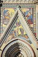 Close up of a gable with mosaics depicting the batism of Christ by John the Baptist created between 1350 and 1390 after designs by artist Cesare Nebbia on the14th century Tuscan Gothic style facade of the Cathedral of Orvieto, designed by Maitani, Umbria, Italy .<br /> <br /> Visit our ITALY HISTORIC PLACES PHOTO COLLECTION for more   photos of Italy to download or buy as prints https://funkystock.photoshelter.com/gallery-collection/2b-Pictures-Images-of-Italy-Photos-of-Italian-Historic-Landmark-Sites/C0000qxA2zGFjd_k<br /> .<br /> <br /> Visit our MEDIEVAL PHOTO COLLECTIONS for more   photos  to download or buy as prints https://funkystock.photoshelter.com/gallery-collection/Medieval-Middle-Ages-Historic-Places-Arcaeological-Sites-Pictures-Images-of/C0000B5ZA54_WD0s